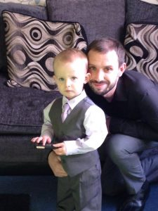 Lee pictured with son at home dressed in their Sunday best