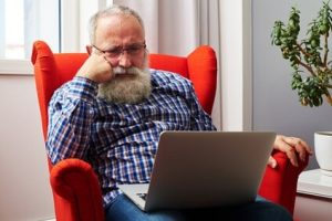 Man Sat In Red Chair Wondering Why He Can't Find His Site In Google